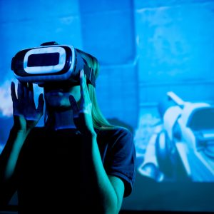 Young developer of new futuristic video game with vr headset